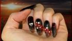 faux ongles en gel noir et fleur 3d rouge