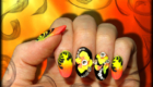 faux ongles en gel orange jaune et noir nail art 3d et strass